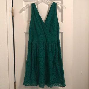 Green lace dress by Aqua